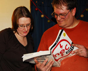 Jonathan explains something to Elaine Fitzpatrick out of the National Electrical Code book.